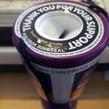 A close up image of a charity collection tin for EACH Milton at Pendred Printing Cambridge