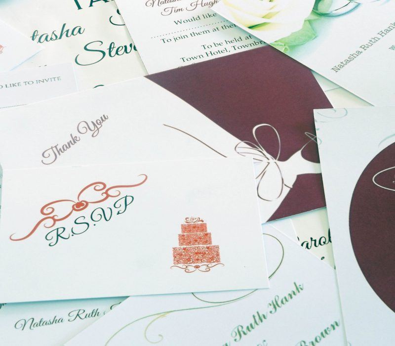 A pile of wedding stationery showing some of the designs and products available for printing at Pendred Printing