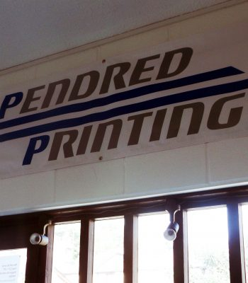 A PVC banner 6ft by 2ft, hanging on the wall of Pendred Printing Cambridge